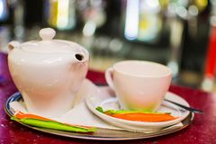Black tea in a ceramic teapot on a tray with a cup.  Stock Photography