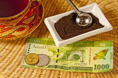 Black tea of Ceylon. With money of Ceylon Royalty Free Stock Photos