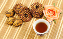 Black tea and  chocolate cookies Royalty Free Stock Image
