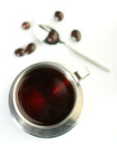 Black tea with chocolate dragees Stock Image