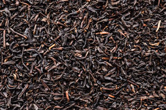 Black tea close up background. Dry black tea close up background Royalty Free Stock Photos