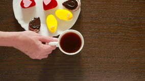 Black tea and coffee in mugs. table with a drink and dessert. Valentine`s Day. Black tea in mugs. lunch. table with a drink and dessert. Valentine`s Day. view stock video