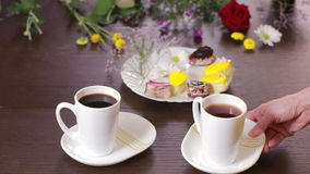 Black tea and coffee in mugs. table with a drink and dessert. view from above. Black tea in mugs. lunch. table with a drink and dessert stock footage
