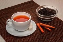 Black tea. Tea composition of black tea with cinnamon and sugar royalty free stock photo