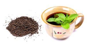Black tea. Concept image of black tea over white background Stock Photos