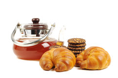 Black tea and croissant Royalty Free Stock Image