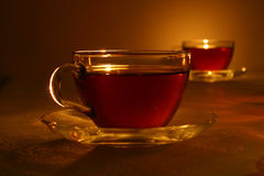 Black tea in crystal cup Royalty Free Stock Photos