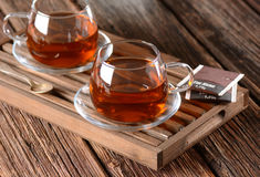 Black tea in cup Stock Images