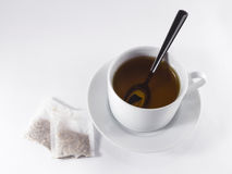 Black tea cup. Hot black tea in white cup on white background whit tea bags royalty free stock image