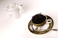 Black tea in cup with pot Royalty Free Stock Photo