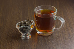 Black tea cup and sugar bowl on the wooden table Stock Images