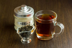 Black tea cup and sugar bowl on the wooden table Royalty Free Stock Image