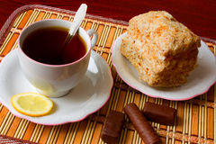 Black tea and dessert. Cup of black tea with lemon, dessert and sweets Royalty Free Stock Photo