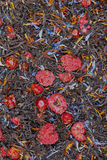 Black tea with dried berries, textura Royalty Free Stock Photo
