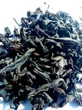The tea is full-leaf chilled black. Black tea is a drink from fermented leaves of a tea plant. The composition of black tea includes caffeine, tannin, catechin Royalty Free Stock Photos