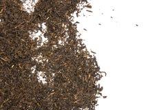 Black tea earl grey isolated on white. Lot of pieces of dry black tea earl grey flatlay isolated on white background stock photos