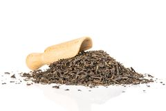 Black tea earl grey isolated on white. Lot of pieces of dry black tea earl grey with wooden scoop isolated on white background royalty free stock photos