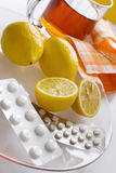 Black tea with fresh lemons and flu pills in blister Stock Images
