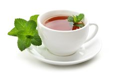 Black tea with fresh mint leaves Stock Photography