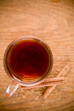 Black tea in glass with cinnamon and cane sugar Royalty Free Stock Photo