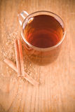 Black tea in glass with cinnamon and cane sugar Stock Image