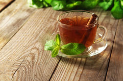 Black tea in a glass cup and saucer Stock Images