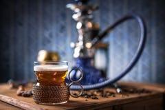 Black tea in glass cup Stock Photos