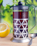 Black tea in a glass teapot. With lemon Stock Photo
