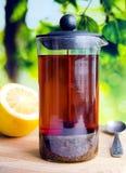 Black tea in a glass teapot Stock Photo