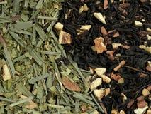 Black tea and green tea with dried fruit Stock Photos