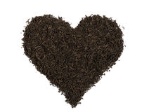 Black tea,  heart-shaped, isolated Royalty Free Stock Photography