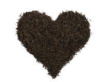 Black tea,  heart-shaped, isolated Royalty Free Stock Photography