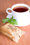 Black tea with herbs Royalty Free Stock Photos