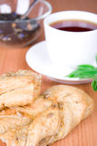 Black tea with herbs and bread Stock Photos