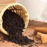 Black Tea in Infuser with Cinnamon Royalty Free Stock Photo