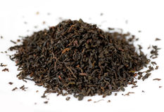 Black tea leaves. Handful of black tea leaves on white background Royalty Free Stock Photo