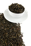 Black tea leaves in a cup Royalty Free Stock Photo