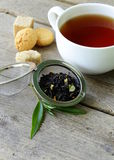 Black tea leaves in a metal strainer Royalty Free Stock Photography