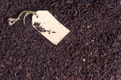Black tea leaves and paper label Royalty Free Stock Image
