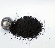 Black tea leaves pile. Earl gray tea. Black tea leaves. Earl gray tea in a pile on a white backround with accessories royalty free stock image