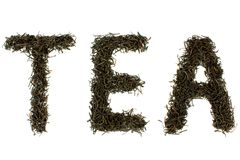 Black tea leaves with \ TEA\ text. Black tea leaves with \TEA\ text on white background Stock Photo