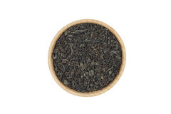 Black tea leaves in a wooden bowl Royalty Free Stock Images
