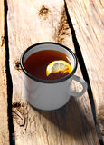 Black tea with lemon. Royalty Free Stock Image