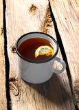 Black tea with lemon. Black tea with a lemon Royalty Free Stock Image