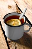 Black tea with lemon. Royalty Free Stock Images