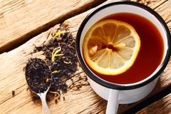 Black tea with lemon. Royalty Free Stock Photography