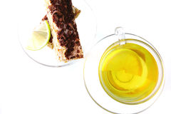 Black tea and lemon cake Stock Photos
