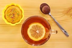 Black tea with lemon and cake Stock Photo