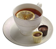 Black tea with lemon and chocolate candy Royalty Free Stock Photo