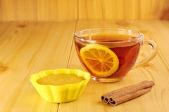 Black tea with lemon and cinnamon muffins Stock Photo